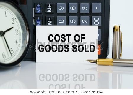 Costs on Chalkboard in the Office. Stock photo © tashatuvango