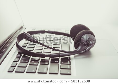 A telephone operator talking into a mic Stock photo © IS2