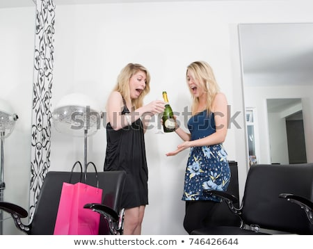 Two women at hairdressers with champagne Stock photo © IS2