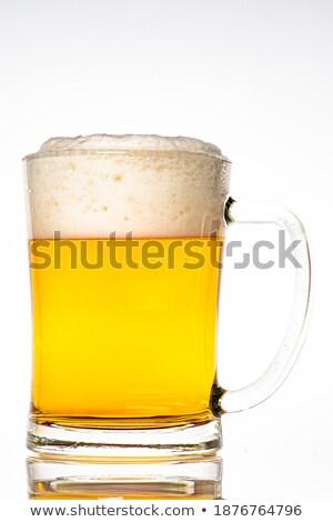 Completo cerveja caneca branco espuma Foto stock © orensila