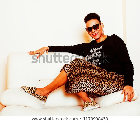 pretty stylish african american big mama woman well dressed swag relax at home leopard print on cl stock photo © iordani