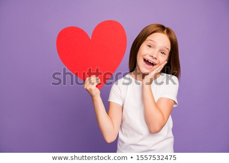 Young boy holding purple paper heart Stock photo © IS2