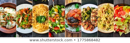 Italian cuisine background with different food on the plates Stock photo © bluering