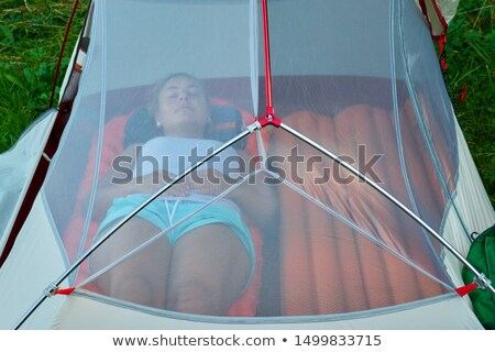 Young girl sleeping in summer netting tent Stock photo © IS2