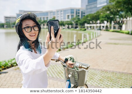 Chinese ethnic clothing woman city bicycle Stock photo © toyotoyo
