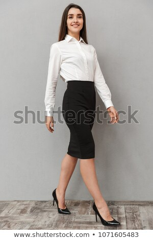 Full length portrait of adorable woman with long brown hair in b Stock photo © deandrobot