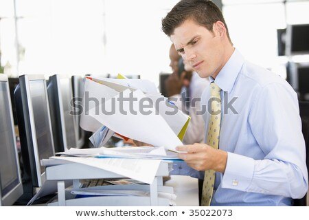 Stock Trader Looking Though Paperwork Stock photo © monkey_business