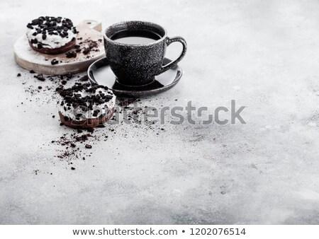 Café preto copo pires preto bolinhos pedra Foto stock © DenisMArt