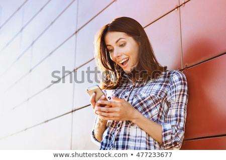 очаровательный · улыбаясь · молодые · деловая · женщина · очки - Сток-фото © boggy