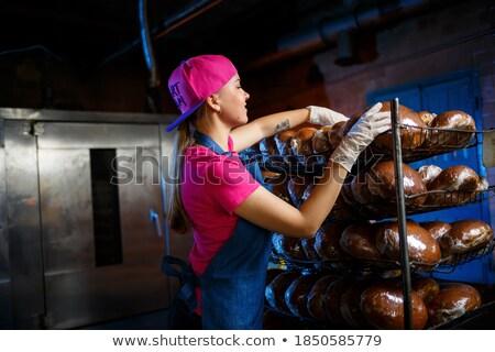Pékség nő kenyér bolt polc elad Stock fotó © Kzenon