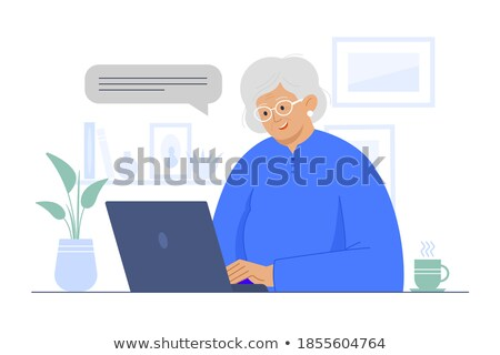 elderly woman sitting at table and working with laptop vector isolated illustration stock photo © pikepicture