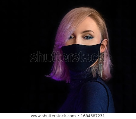 Cute young blonde in black clothes Stock photo © acidgrey