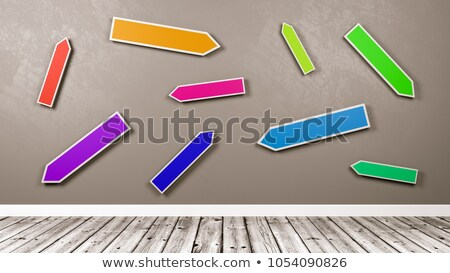 Colorful Directional Arrows Road Sign  Against Gray Wall Stock photo © make