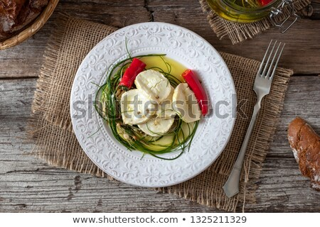Goat cheese pickled with crow garlic in olive oil Stock photo © madeleine_steinbach
