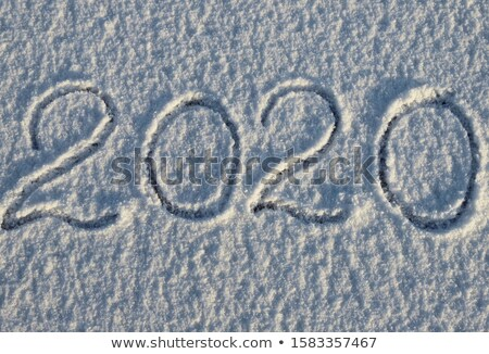 new year 2020 number or date on snow surface Stock photo © dolgachov