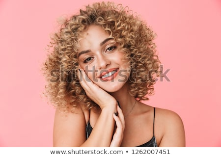 portrait closeup of caucasian curly woman 20s wearing dress smil stock photo © deandrobot