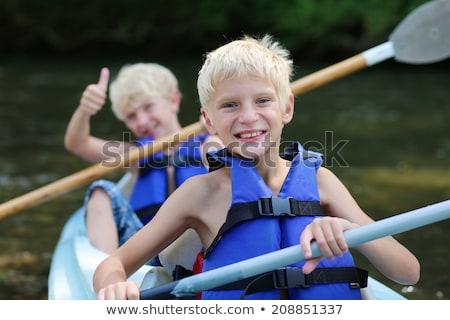 adam · kadın · kürek · çekme · tekne · göl · sevmek - stok fotoğraf © lopolo