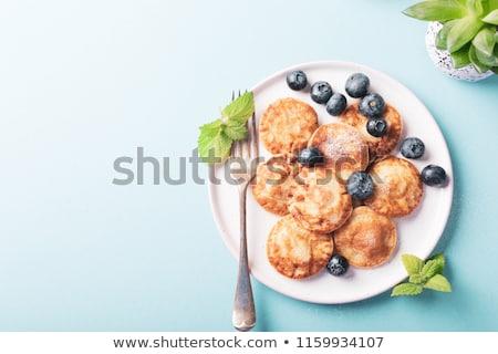 オランダ語 ミニ パンケーキ 粉砂糖 プレート 白 ストックフォト © Melnyk