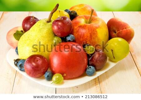 Abondance fruits plaque table alimentaire dîner Photo stock © galitskaya