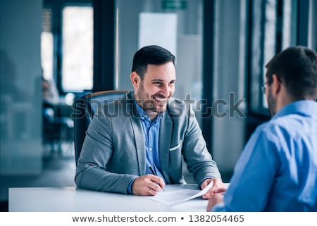 Happy business executive signing a contract. Stock photo © lichtmeister