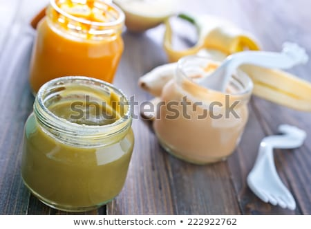 vegetable or fruit puree or baby food in jars Stock photo © dolgachov