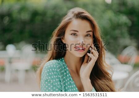 Vízszintes lövés csinos fiatal nő blúz telefonbeszélgetés Stock fotó © vkstudio