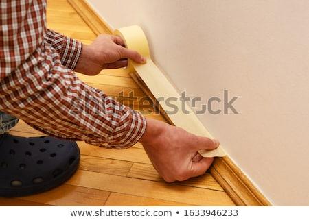 House Painter glues masking tape Stock photo © Kotenko