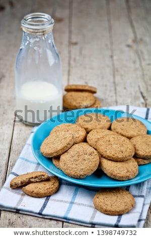 Fresh baked oat cookies on blue ceramic plate on linen napkin on Stock photo © marylooo
