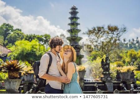 Happy loving couple in Taman Tirtagangga, Water palace, Water park, Bali Indonesia. Honeymoon in Bal Stock photo © galitskaya