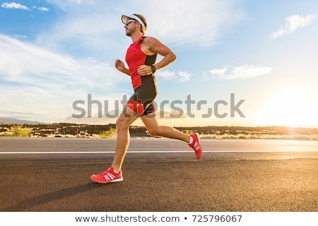 Triathlon corredor homem corrida terno estrada Foto stock © Maridav
