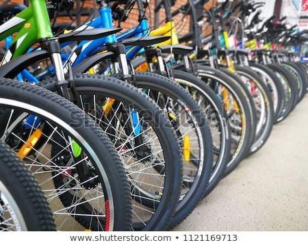 Row of bicycle tires Stock photo © bobkeenan
