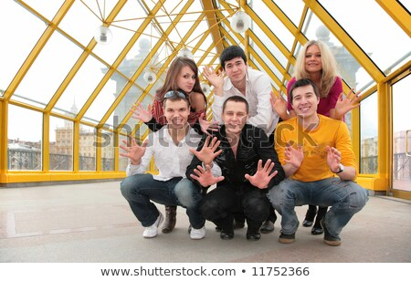 group of young people demonstrates open palms on footbridge Stock photo © Paha_L
