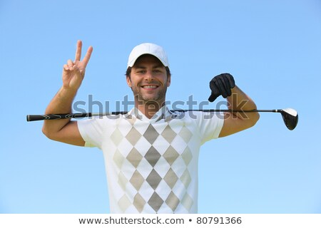 Golfer giving peace sign Stock photo © photography33