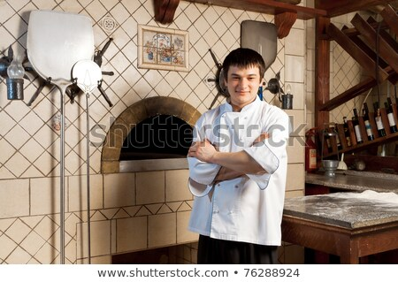 italian chef next to a pizza oven stock photo © photography33