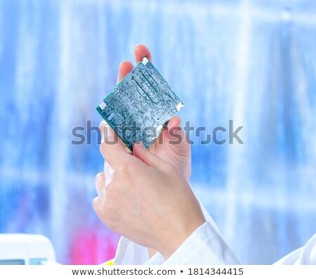 Nő forrasztás televízió tájkép kék dolgozik Stock fotó © photography33