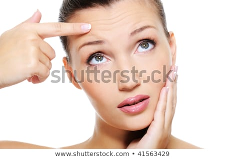 Young woman touching her forehead Stock photo © photography33