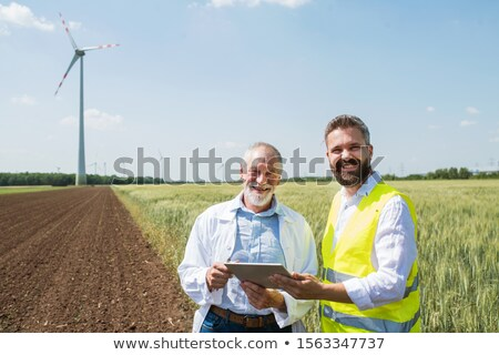 old windmill making electric power stock photo © stuartmiles