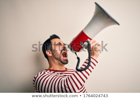 young man yelling in a megaphone Stock photo © photography33