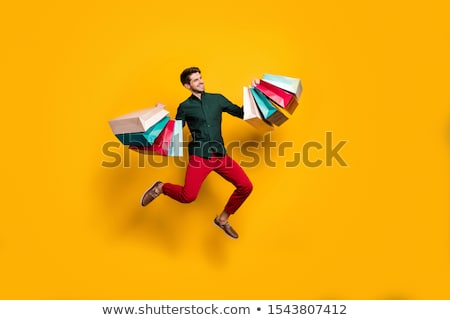 Man holding numerous shopping bags Stock photo © photography33
