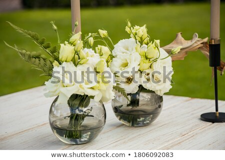 tenderness with flowers stock photo © dolgachov