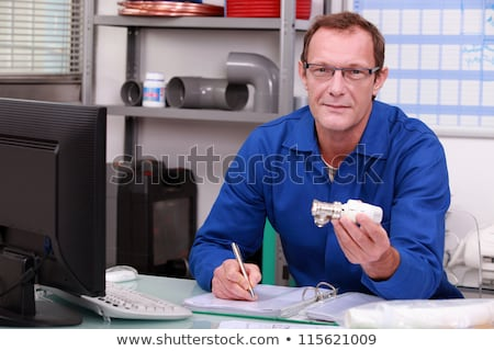 Plumber at a counter with a radiator valve Stock photo © photography33