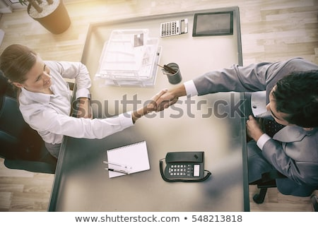 above view of young consultant shaking hands with customer stock photo © wavebreak_media