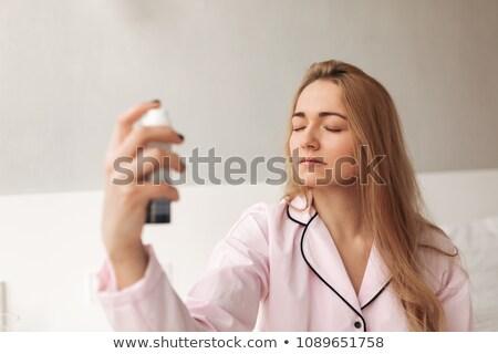 眠い 若い女性 スプレー ボトル 白 ストックフォト © wavebreak_media