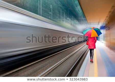 young blond girl on railway tracks stock photo © rhamm