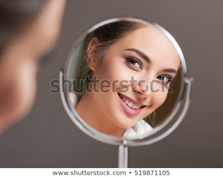 Belle femme regarder miroir up main Photo stock © lunamarina