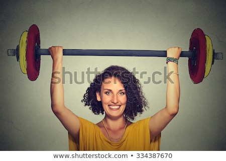 female weight lifter with happy expression stock photo © jasminko