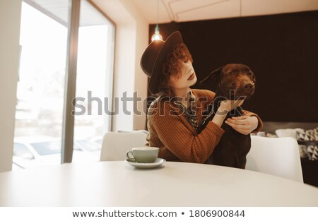 Iki mutlu kadın oturma sehpa Stok fotoğraf © Rob_Stark