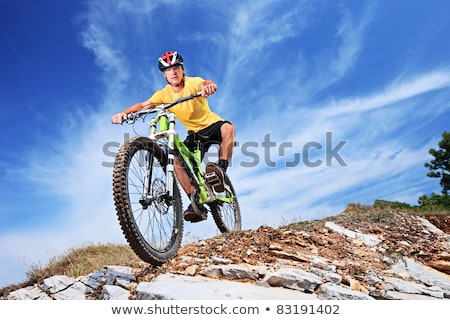 young boy with helmet is riding mountain bike stock photo © meinzahn