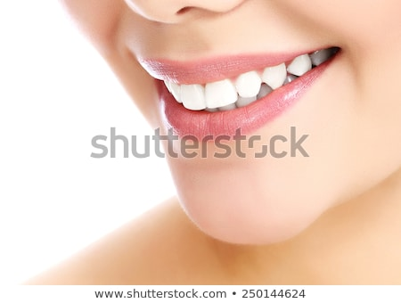 dentaires · dents · parfait · sourire · femme · pointant - photo stock © nobilior