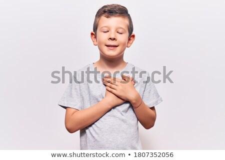 portrait of cute boy with closed eyes in studio stock photo © meinzahn